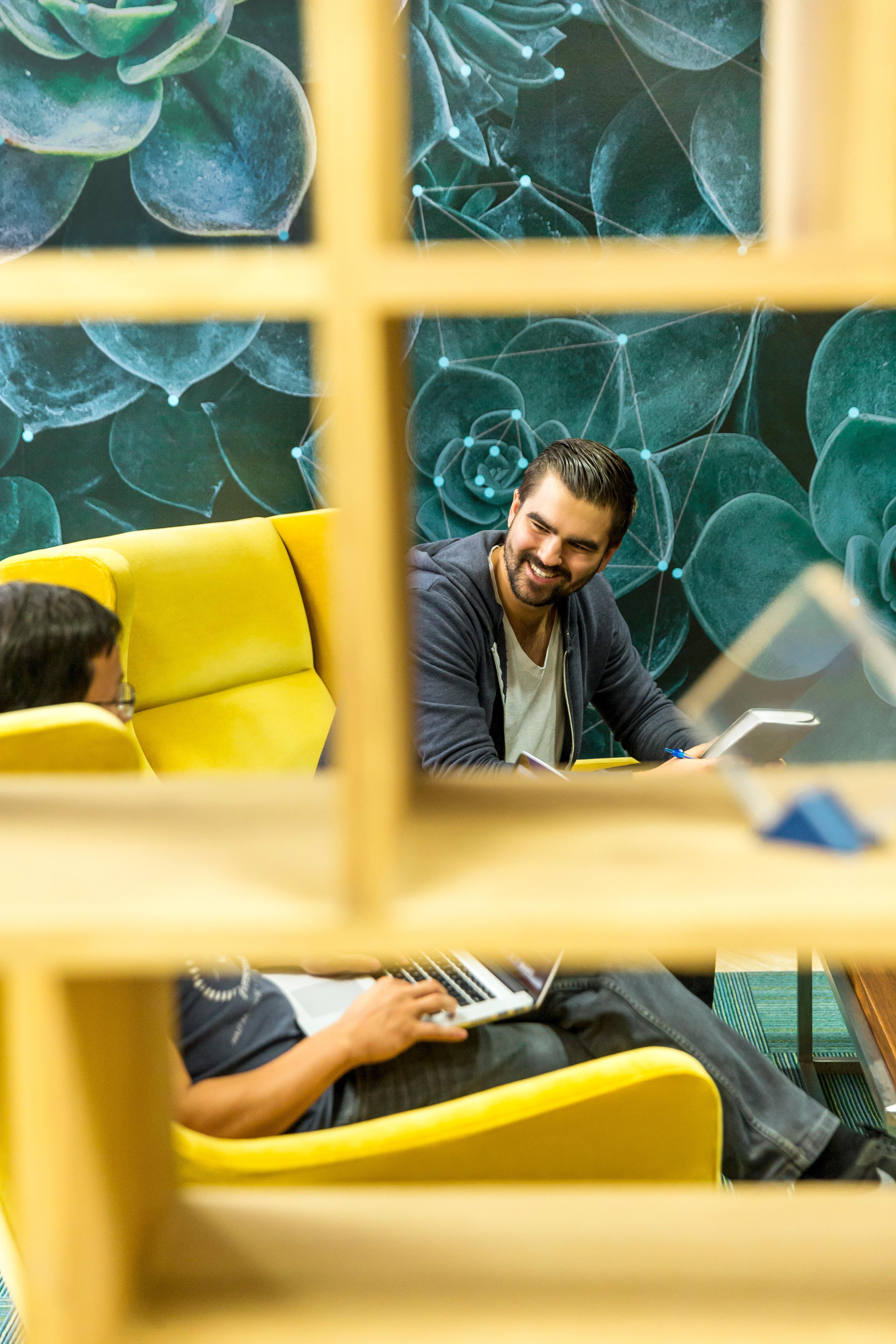 man laughing in meeting